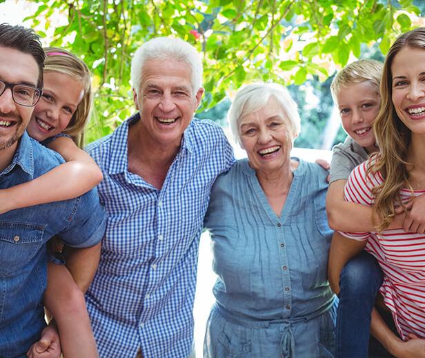 happy, smiling grandparents, parents, and children